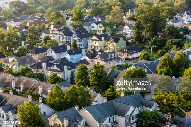 aerial view of house roofs in suburban neighborhood - residential district stock pictures, royalty-free photos & images