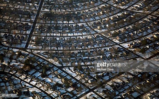 aerial view of houses in queens brooklyn w snow