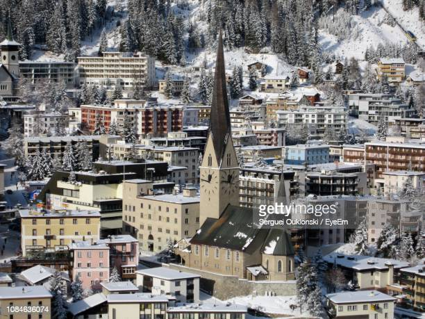 aerial view of houses in town - davos stock pictures, royalty-free photos & images