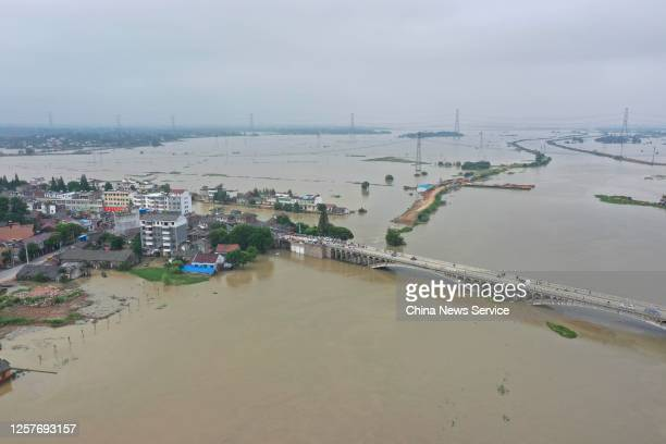 Aerial view of houses surrounded by flood water after the breach of a river embankment at Lujiang County on July 23, 2020 in Hefei, Anhui Province of...