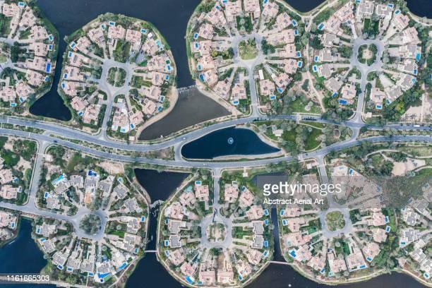 aerial view of housing development, dubai, united arab emirates - dubai stock pictures, royalty-free photos & images