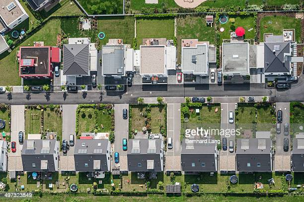 aerial view of housing development - 宅地 ストックフォトと画像
