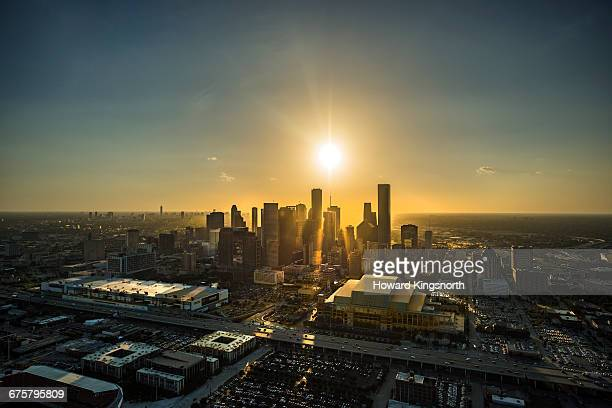 aerial view of houston at sunset - houston stock pictures, royalty-free photos & images