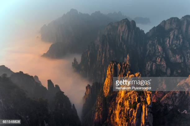 aerial view of huangshan mountain with fog scene - lotus flower peak stock pictures, royalty-free photos & images