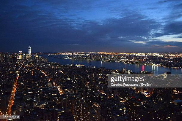 aerial view of hudson river amidst illuminated cityscape against sky at night - carolina fragapane stock pictures, royalty-free photos & images