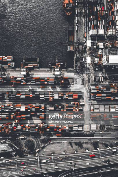 aerial view of huge industrial port with cargo containers. commercial logistics industry of china hong kong - global trade war stock pictures, royalty-free photos & images