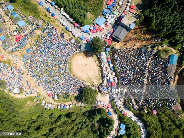 Aerial view of hundreds of thousands of villagers gathering together to watch bullfighting on the sixth day of the sixth lunar month at Congjiang...