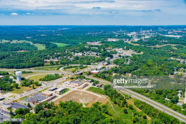 aerial view of hwy 76 and hwy 65 intersection in branson, missouri - 1011957648,1011945618,1011950492,1011960800,1011954950,1011953954,1015768380,1015768366,1015768370,1015768372,1015768382,1015768398,1015768412,1015768410,1015768414,1015768418,1015768438,1015768448,1015768450,1015768488,1015768474,1015768478,1015768504,1015768508,1016083590,1016083634,1016083592,1016083608,1016083686,1016083708,1016083780,1016083774,1016083796,1016083828,1016083994,1016083992,1016083982,1016083980 stock pictures, royalty-free photos & images
