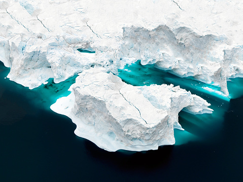Aerial view of icebergs on Arctic Ocean in Greenland 899103038