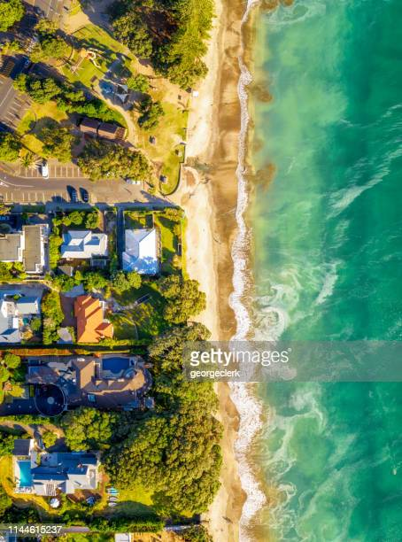 aerial view of idyllic beachside homes - coastline stock pictures, royalty-free photos & images