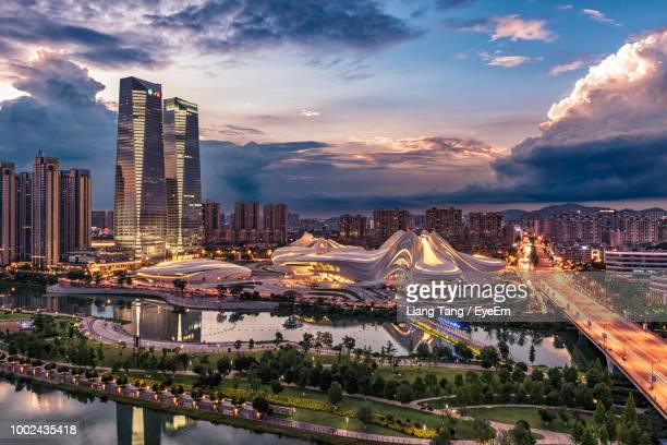aerial view of illuminated bridge and buildings against sky - changsha stock pictures, royalty-free photos & images