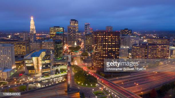 aerial view of illuminated buildings against sky at night - hartford connecticut stock pictures, royalty-free photos & images