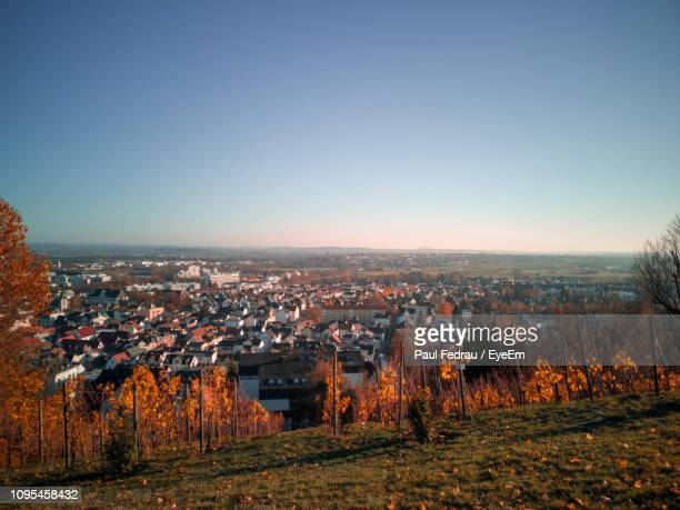 aerial view of illuminated buildings in city against clear sky - bad homburg stock pictures, royalty-free photos & images