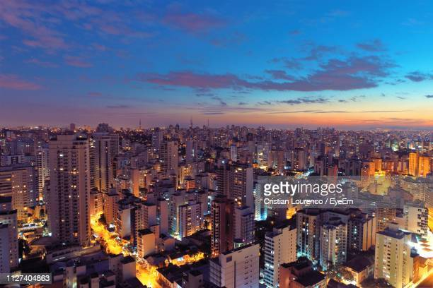 Aerial View Of Illuminated Buildings In City Against Sky During Sunset
