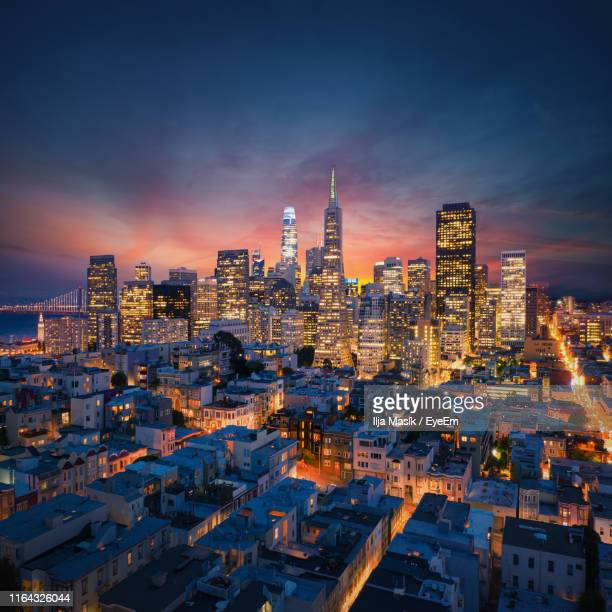 aerial view of illuminated buildings in city at night - san francisco california stock pictures, royalty-free photos & images