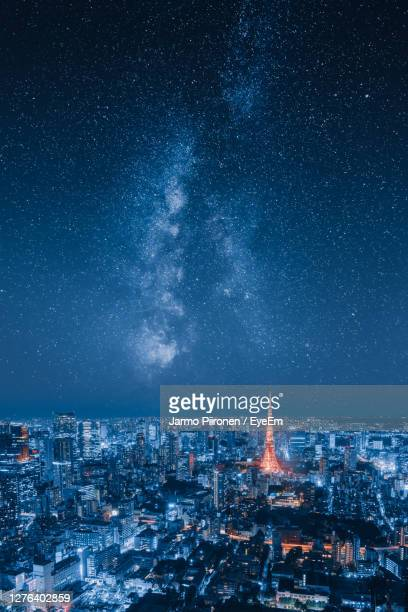 aerial view of illuminated buildings in city at night - tokyo japan stock pictures, royalty-free photos & images