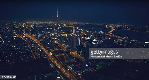 Aerial View Of Illuminated Burj Khalifa And Cityscape Against Sky At Night