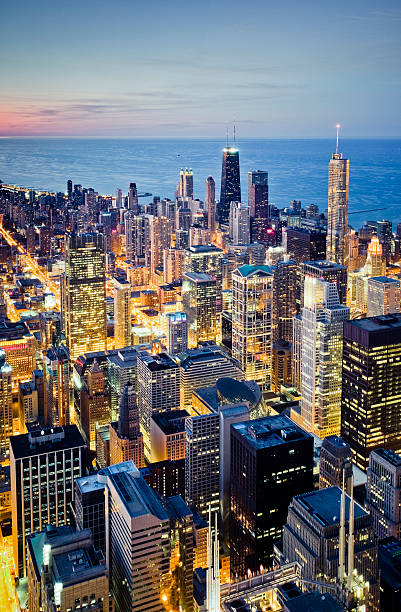 Aerial view of illuminated Chicago cityscape at dusk