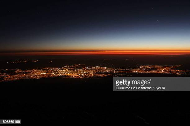 Aerial View Of Illuminated City Against Sky During Sunset