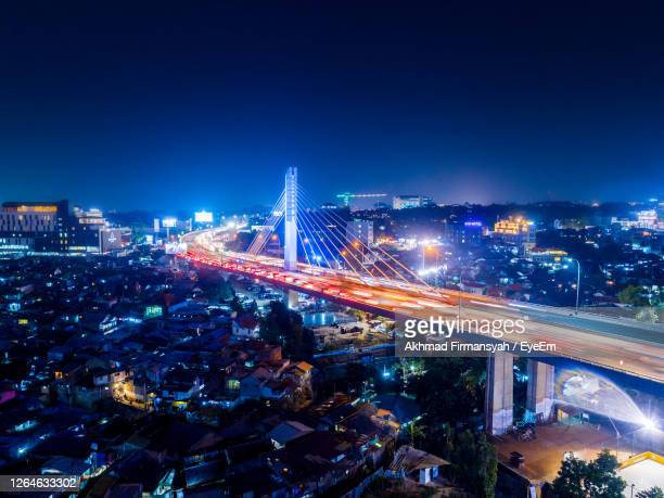 aerial view of illuminated city at night - bandung stock pictures, royalty-free photos & images