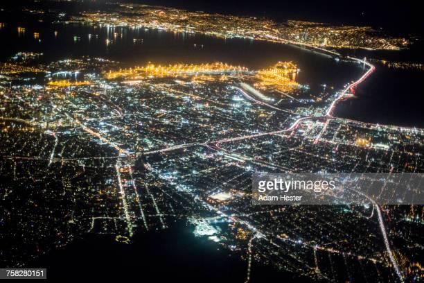 aerial view of illuminated city at night - oakland califórnia - fotografias e filmes do acervo