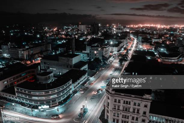 aerial view of illuminated city at night - mombasa stock photos and pictures