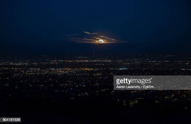 aerial view of illuminated city at night - fort collins stock pictures, royalty-free photos & images