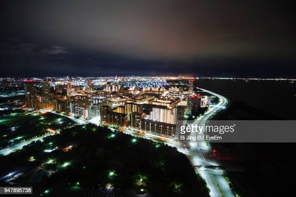 aerial view of illuminated city at night - 千葉市 ストックフォトと画像