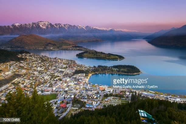 aerial view of illuminated city at waterfront - wellington new zealand stock photos and pictures