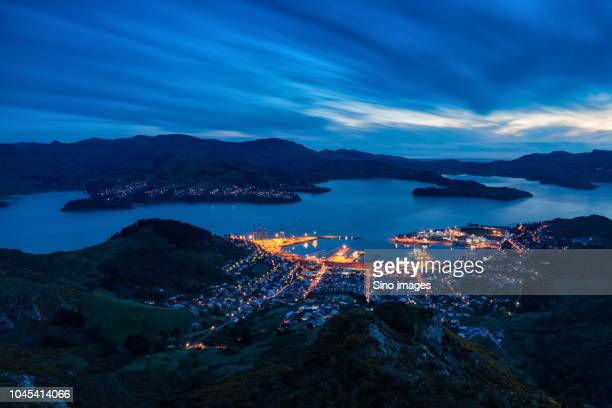 aerial view of illuminated city, new zealand - image stock pictures, royalty-free photos & images