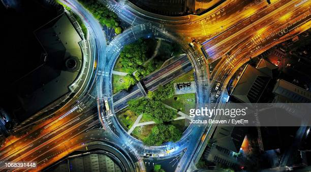aerial view of illuminated city street at night - birmingham england stock photos and pictures