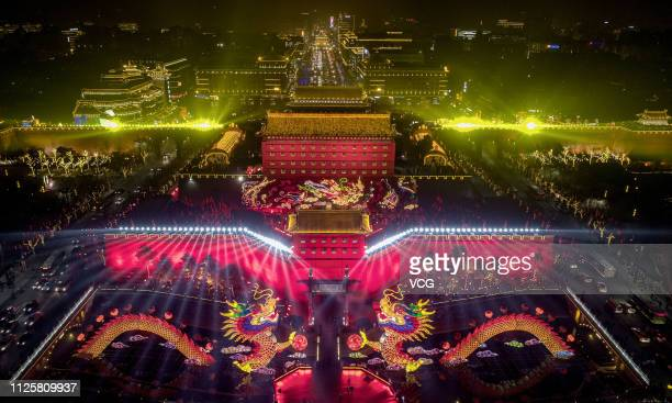 XI'AN CHINA JANUARY 28 Aerial view of illuminated city wall and two dragon shaped colored lanterns during Xi'an city wall lantern show at a square...