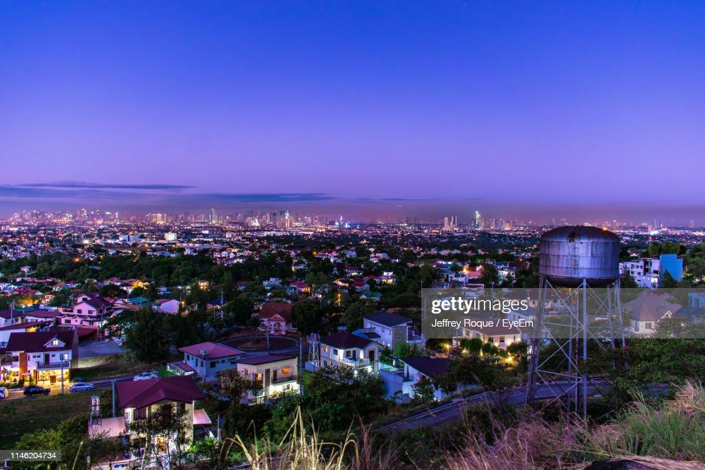 Aerial View Of Illuminated Cityscape Against Blue Sky At Dusk : Stock Photo