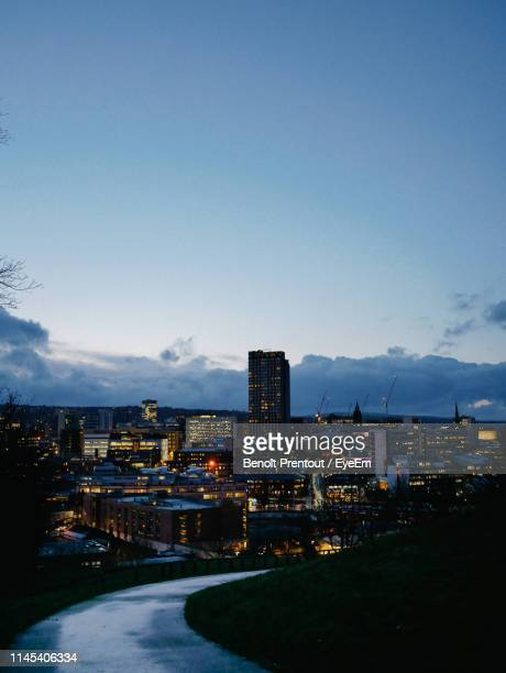 aerial view of illuminated cityscape against sky at dusk - sheffield stock pictures, royalty-free photos & images