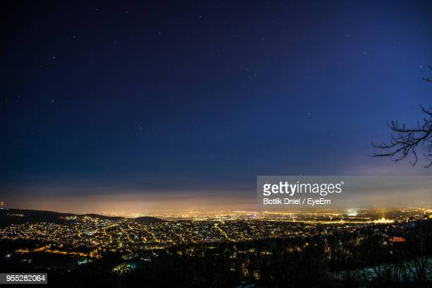 aerial view of illuminated cityscape against sky at night - space and astronomy stock pictures, royalty-free photos & images