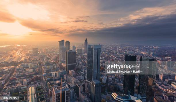 aerial view of illuminated cityscape against sky at sunset - frankfurt am main stock-fotos und bilder