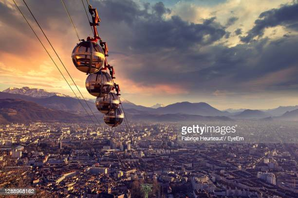 aerial view of illuminated cityscape against sky during sunset - grenoble stock pictures, royalty-free photos & images
