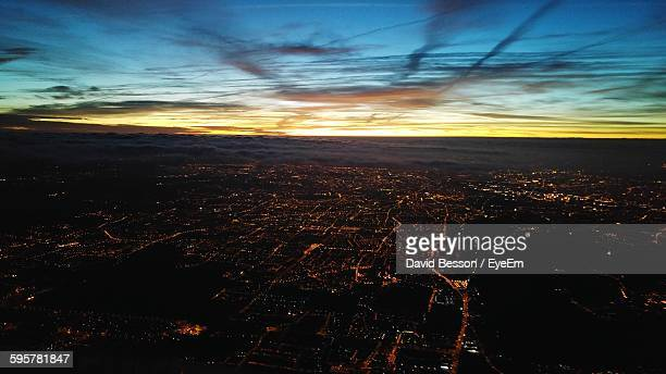 Aerial View Of Illuminated Cityscape Against Sky During Sunset