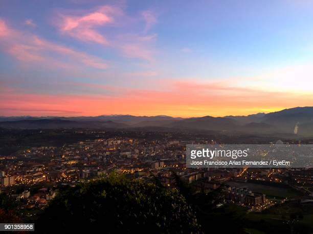 aerial view of illuminated cityscape against sky during sunset - oviedo stock pictures, royalty-free photos & images