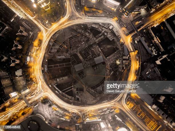 aerial view of illuminated cityscape at night - wuhan ストックフォトと画像