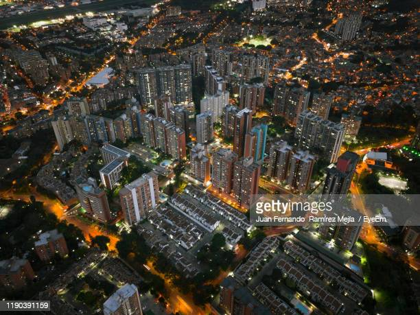 aerial view of illuminated cityscape at night - medellin colombia stock pictures, royalty-free photos & images
