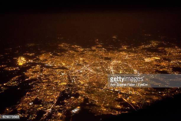 aerial view of illuminated cityscape at night - ile de france photos et images de collection