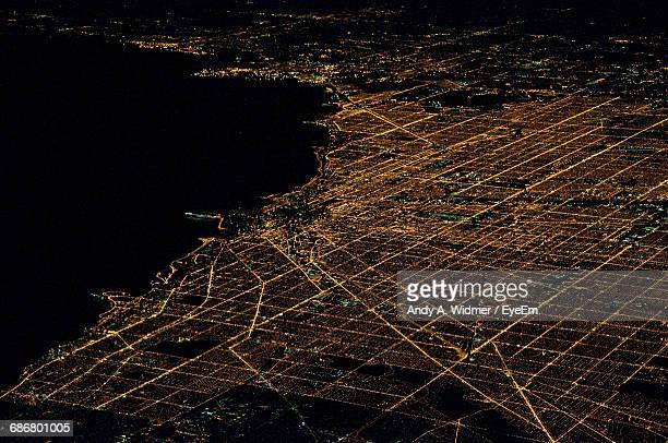 aerial view of illuminated cityscape by river at night - grid pattern stock pictures, royalty-free photos & images