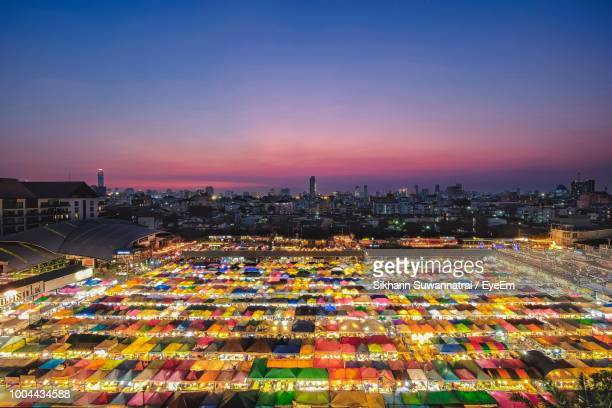 Aerial View Of Illuminated Colorful Night Market In City Against Sky