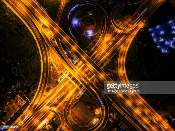Aerial View Of Illuminated Highway In City At Night
