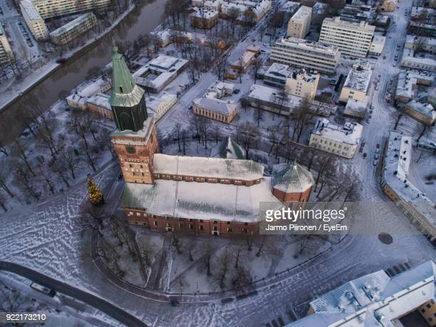 aerial view of illuminated historic church during sunset - turku finland stock photos and pictures
