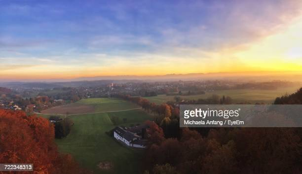 aerial view of illuminated landscape against sky at sunset - anfang stock pictures, royalty-free photos & images