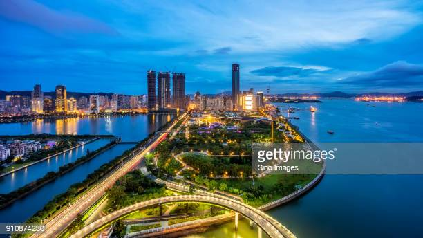 aerial view of illuminated overpass at night,xiamen,fujian, china - xiamen stock photos and pictures