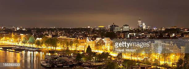 Aerial view of illuminated streets at night, Amsterdam, panorama