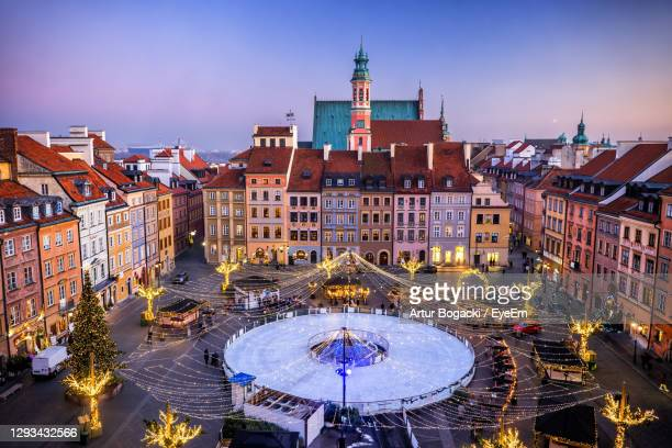 aerial view of illuminated trees by tent in city - warsaw stock pictures, royalty-free photos & images